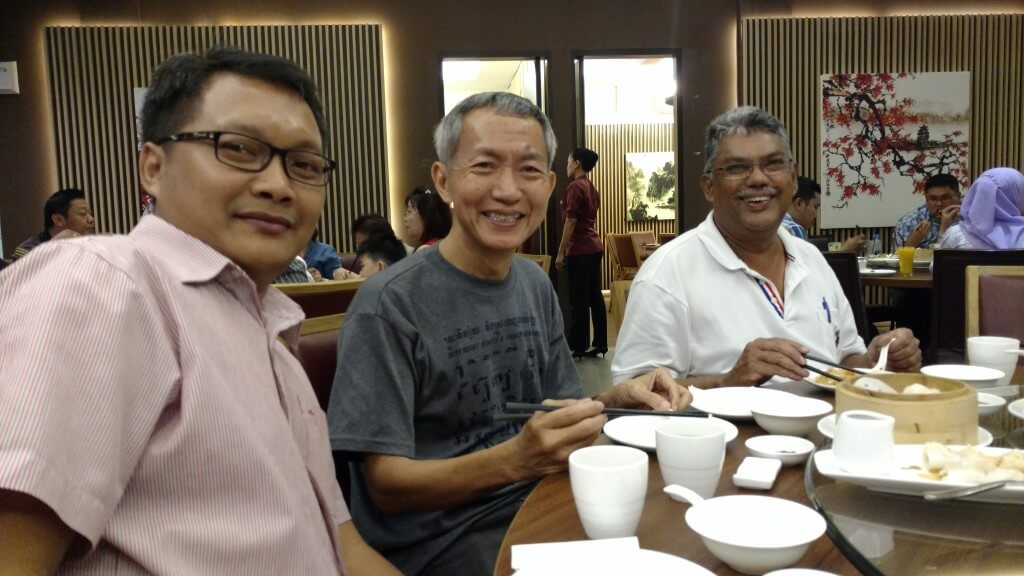Henok with two guests from Singapore
