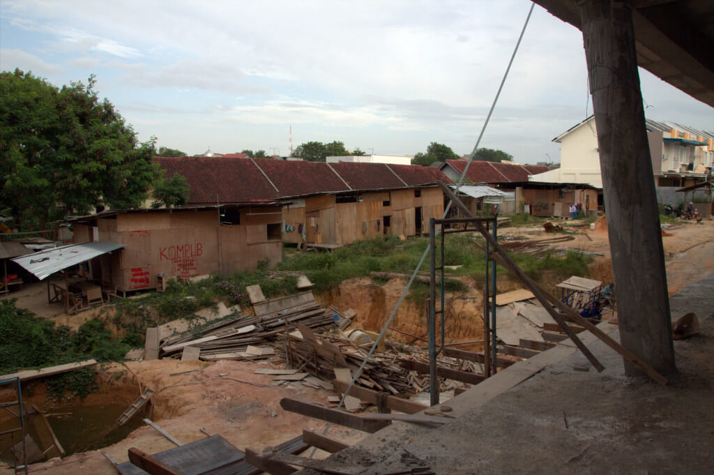 Those plywood houses are where the workers live.  They are from Java.